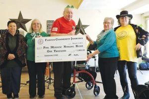 Donation cheque to Pine Meadow Nursing Home in Northbrook, Ontario